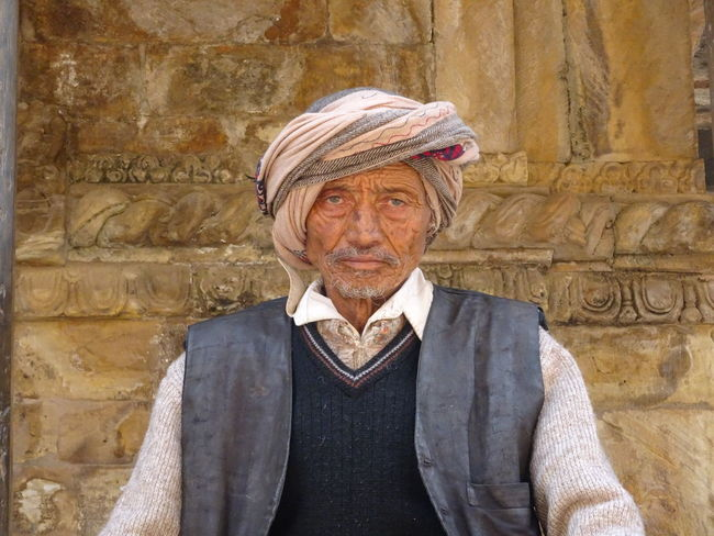 Proud Architecture Auto Post Production Filter Casual Clothing Day EarthquakeNepal Front View Headshot Homless International Landmark Lifestyles Looking At Camera Mature Adult Person Portrait Senior Adult The Past Wall - Building Feature Young Adult