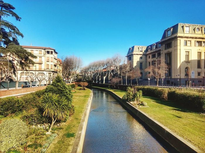 River Perpignan France Water City Clear Sky Tree Blue Cityscape Sunlight Sky Architecture Building Exterior