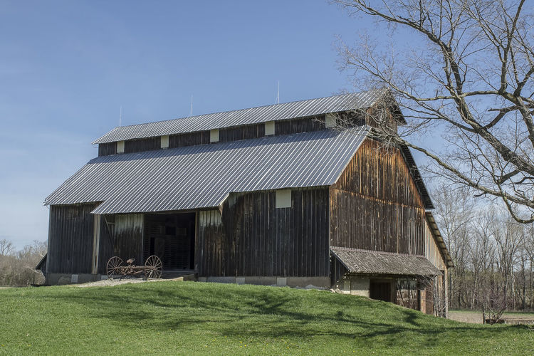 A beautiful barn at the beginning of spring. Architecture Built Structure Sky Tree Nature Building Landscape Grass Barn Agricultural Building Environment Outdoors Clear Sky Americana Serene Wooden Barn Vintage Country Life Countryside Country Scene