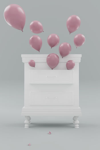 classic white bedside table with open cabinet to let the pink ballons flying away Balloon Studio Shot Pink Color Large Group Of Objects Still Life Helium Balloon Furniture Decoration Flying Away Balloons Open Cabinet Celebration Beginning Of Spring Bedside Table Drawer Fragility Minimalism Minimalistic Soft Spring Season  Table Rise Wooden Style Interior Classic Vintage White Color Concept Cupboard Luxury Blossom Detail Fly Old Old-fashioned Seasonal Studio Symbolic