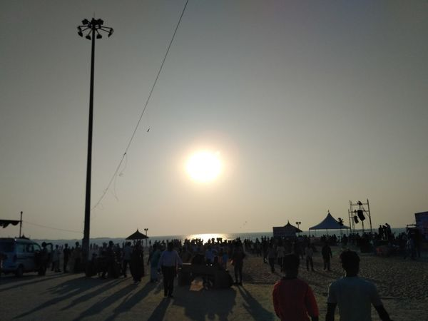 Large Group Of People Sunset People Adult Sun Togetherness Crowd Outdoors Sea And Sky