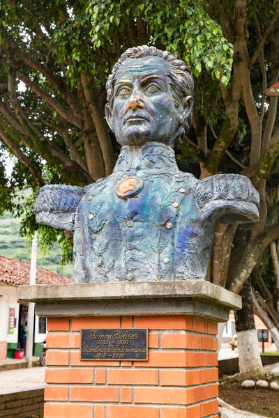Bust of revolutionary fighter Simon Bolivar in Cabrera, Colombia. American Bolivar Colombia Latin Revolutionary Simon South Tourist Travel America Attraction Cabrera Colombian  Colonial Cundinamarca Destination Historical History No People Old Outdoors Sculpture Statue Tourism Tree
