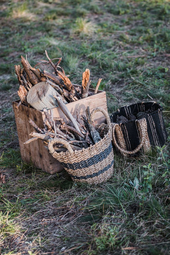 High angle view of firewood in basket on field