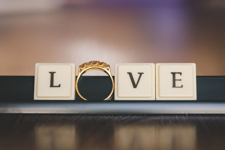 Text Communication Close-up Western Script Capital Letter Letter Still Life Indoors  Table No People Toy Block Selective Focus Focus On Foreground Wood - Material Alphabet Block Love Black Color Single Word Gold Colored Ring