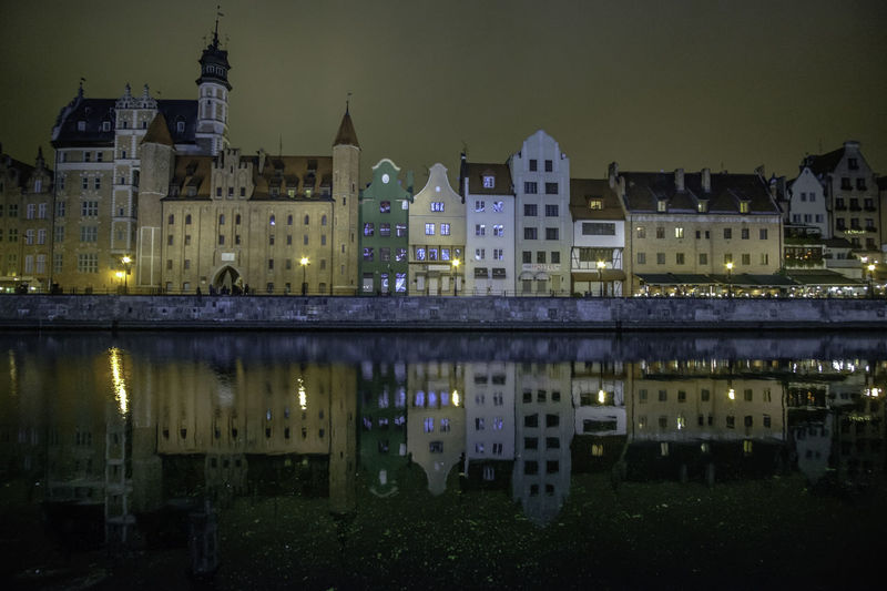 Architecture Building Exterior City Cityscape Gdansk Illuminated Night Nightscape No People Outdoors Poland Reflection Sky Tenement Tenement Building Tenement Houses Travel Destinations Urban Skyline Water