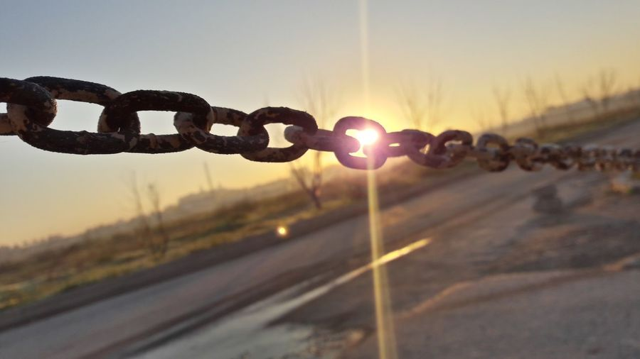 Ther a always hope Sunset Security No People Protection Outdoors Sky Close-up Day Chainlink Fence Chainlink Clear Sky Freshness Backgrounds Water Growth Beauty In Nature Sunlight City Business Finance And Industry