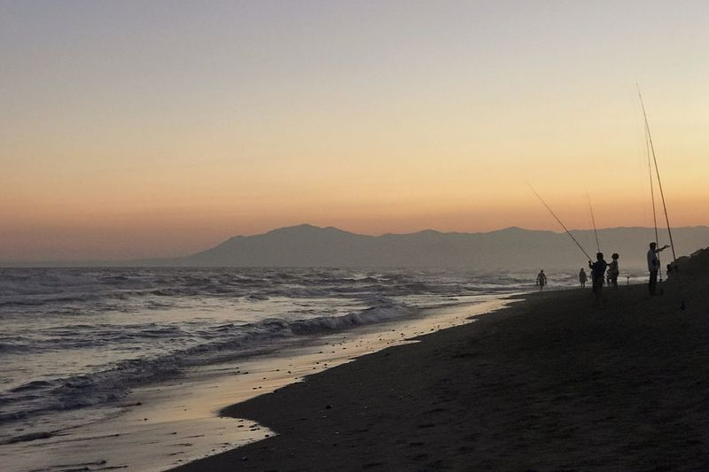 Sommergefühle Sea Beach Sunset Nature Beauty In Nature Scenics Shore Water Real People Sand Silhouette Horizon Over Water Sky Tranquil Scene Leisure Activity Men Outdoors Standing Clear Sky Wave