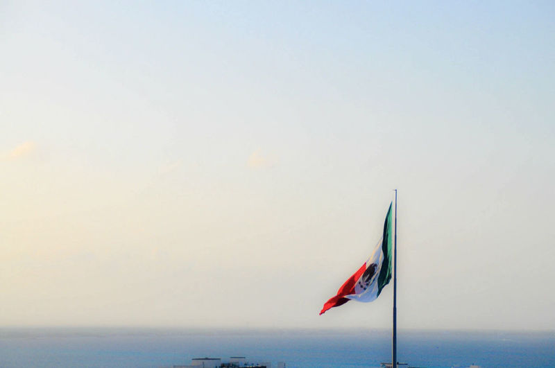 Flag against sky at sea