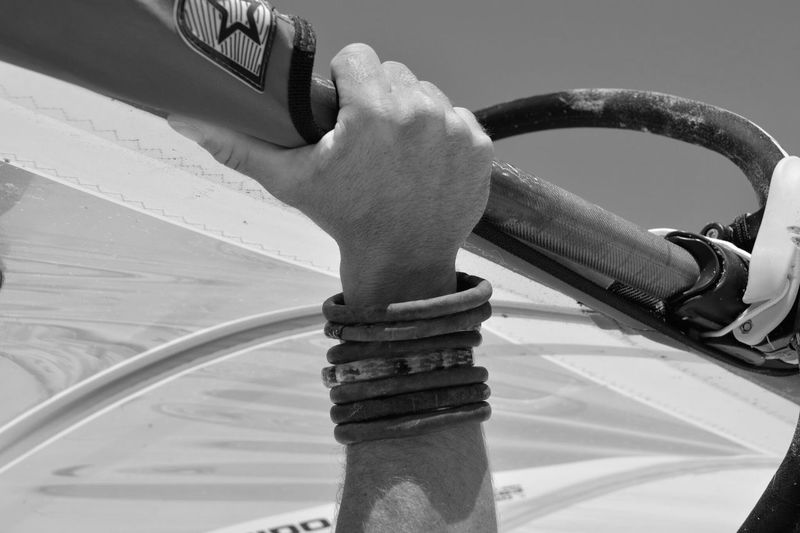 Close-up of hand on boat