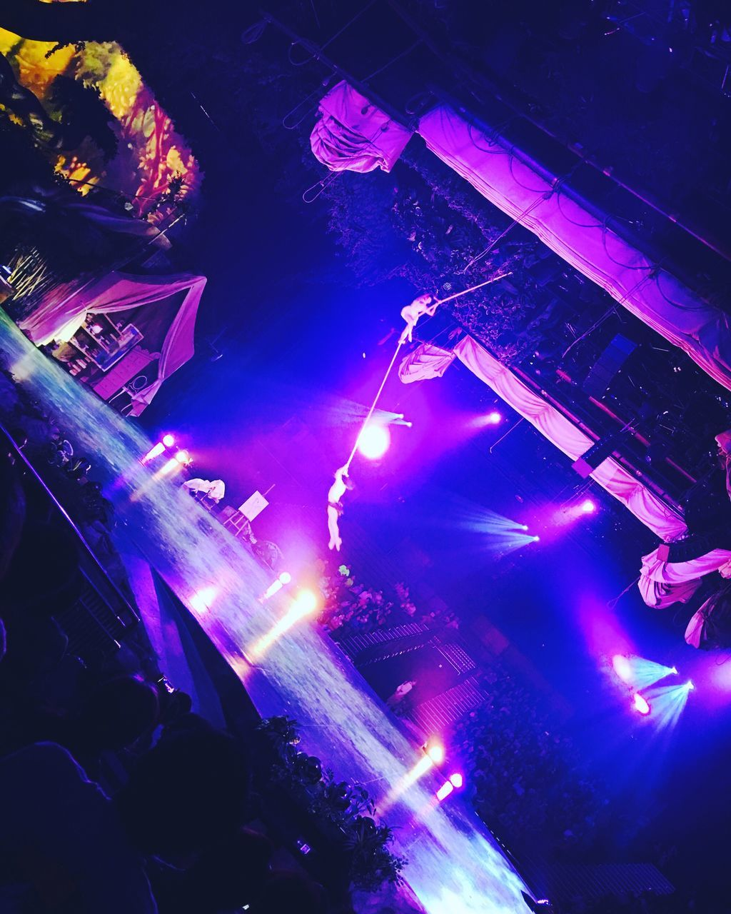 music, illuminated, nightlife, arts culture and entertainment, crowd, large group of people, night, performance, event, indoors, enjoyment, audience, real people, leisure activity, men, nightclub, popular music concert, stage light, youth culture, rock music, disco lights, people