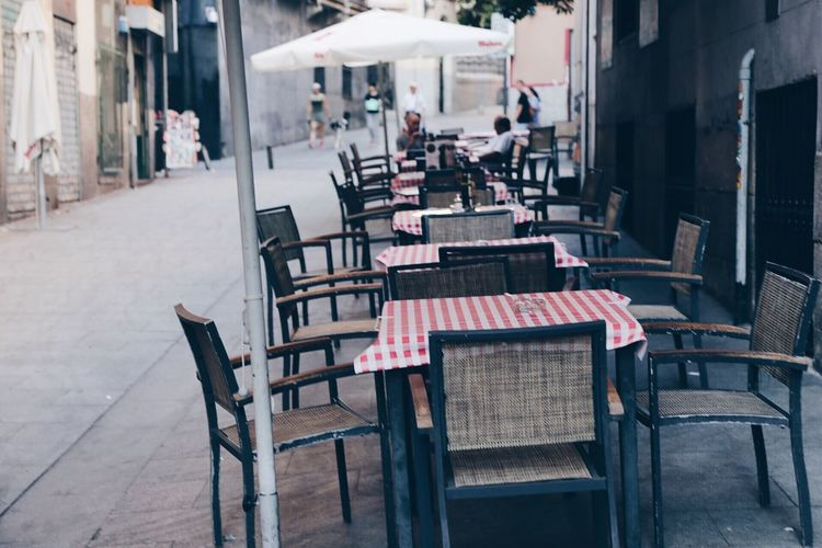 Row Of Tables And Chairs At Sidewalk Cafe