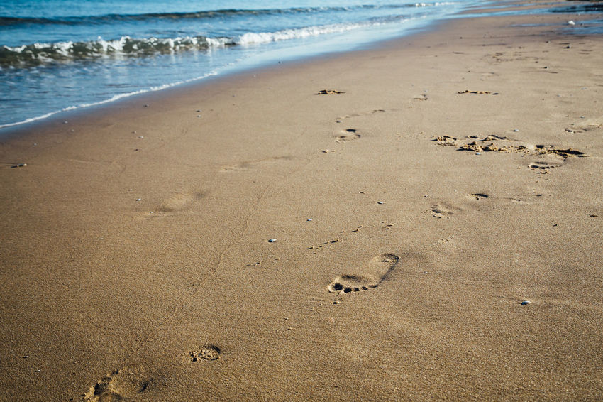 footsteps on the beach Algarve Footsteps In The Sand Absence Beach Beauty In Nature Day FootPrint Footsteps High Angle View Land Motion Nature No People Outdoors Print Sand Sea Track - Imprint Tranquility Water Wave Wet