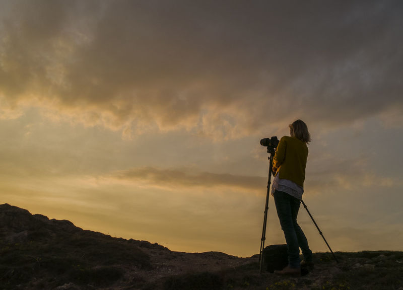 sunset photographer Cloud - Sky Cloudscape Dramatic Sky One Person Outdoors Photographer Silhouette Sky Standing Sunset