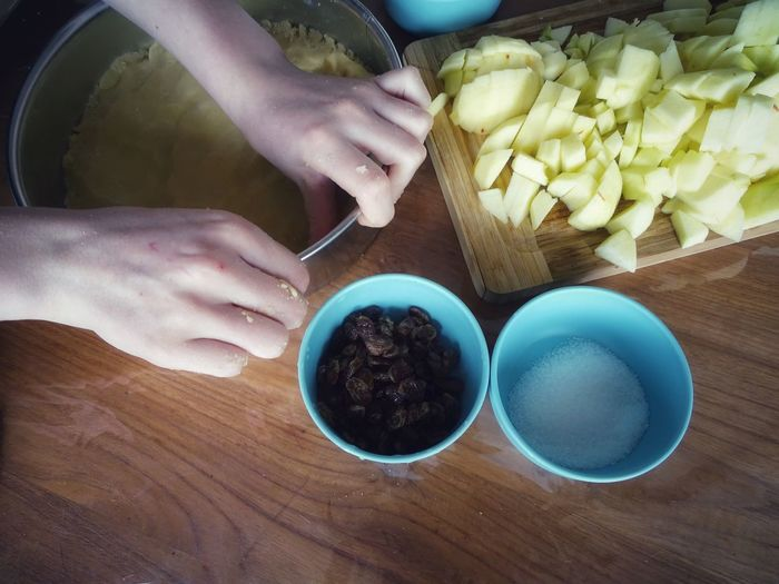 Baking applepie Delicious Eating Raisins Baking Apple Pie Sugar Apple - Fruit Kneading Kneading Dough Dough Dough Preparation Applepie Human Hand Human Body Part Food And Drink Freshness One Person Drink Table High Angle View Food People Bowl