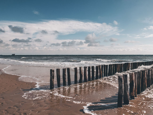 Beach Beauty In Nature Cloud - Sky Horizon Horizon Over Water Land Motion Nature No People Outdoors Sand Scenics - Nature Sea Sky Sport Sunlight Tranquil Scene Tranquility Water Wave Wooden Post