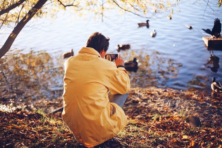 Photographer Using My Mobile Using Phone Fall Fall_collection Autumn colors Autumn🍁🍁🍁 Rear View Real People Water Nature Men Lake Leisure Activity Lifestyles People Photography Themes Photographing Camera - Photographic Equipment Activity Outdoors Duck Vertebrate