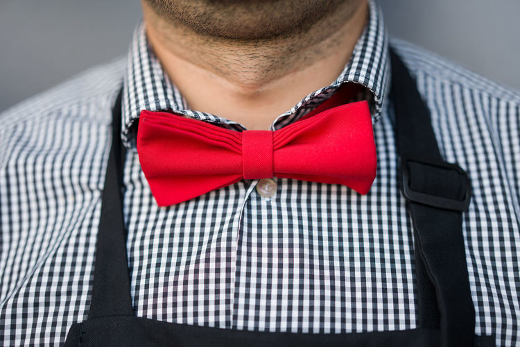 Close-Up Of Man Wearing Red Bow