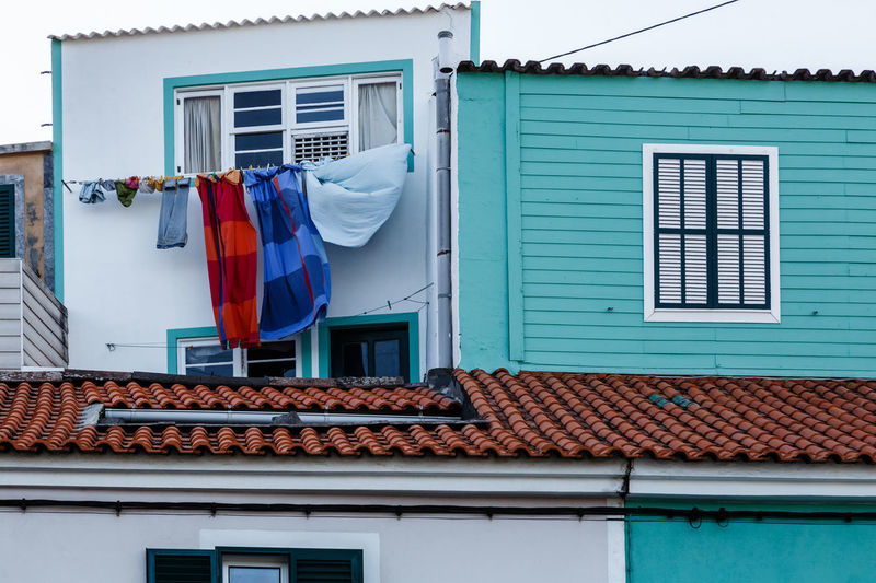 Clothes drying outside house