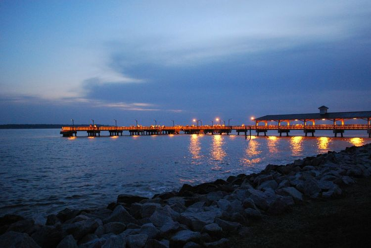 View Of Bridge Over Sea At Sunset
