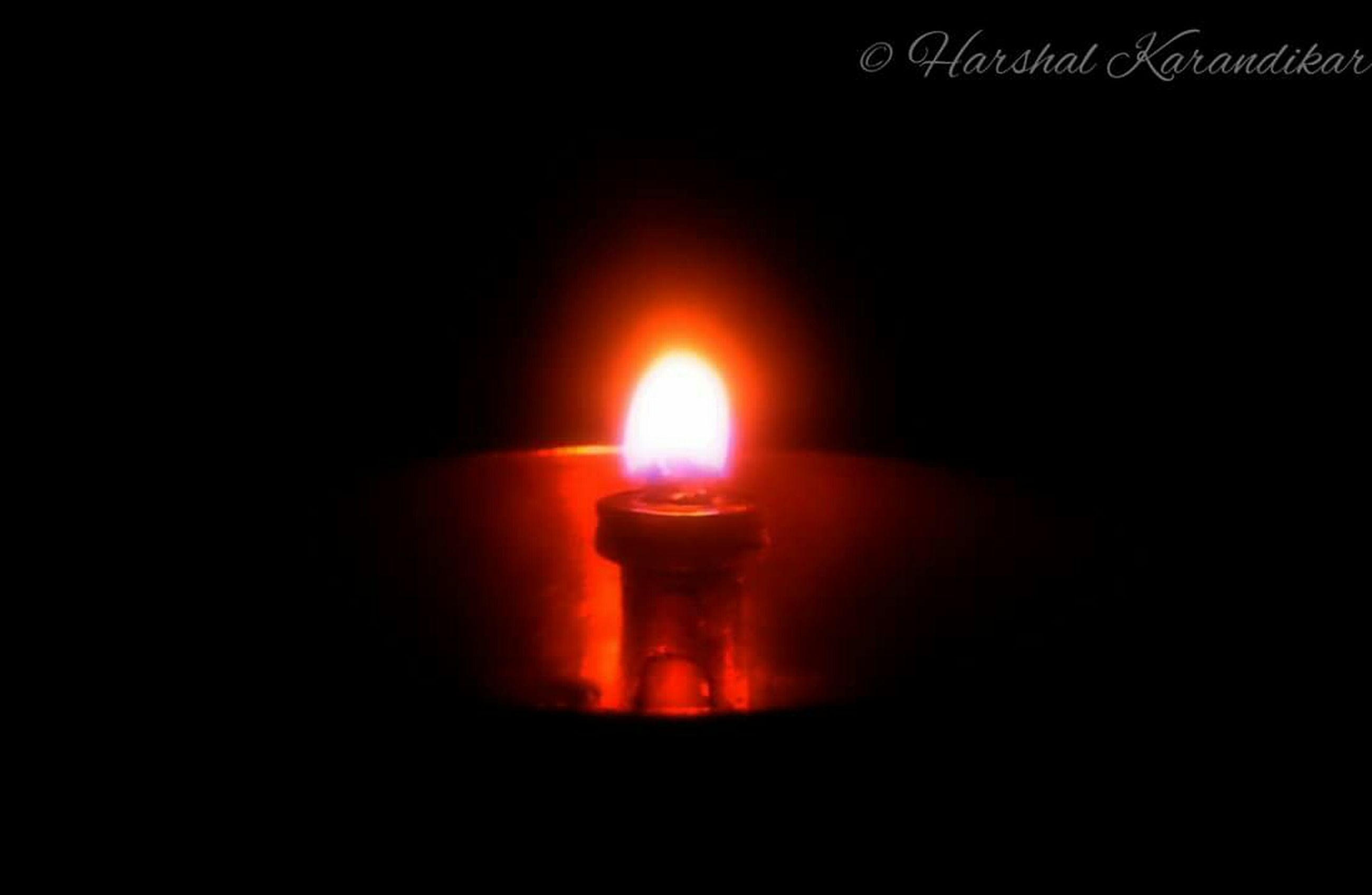 flame, burning, illuminated, glowing, heat - temperature, fire - natural phenomenon, candle, lit, dark, indoors, darkroom, copy space, close-up, night, studio shot, candlelight, black background, fire, lighting equipment, light - natural phenomenon