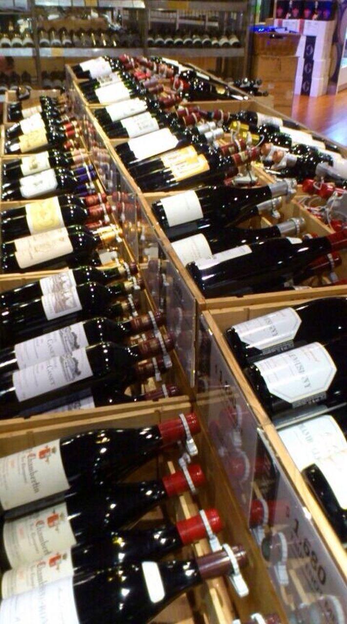 bottle, indoors, shelf, variation, wine bottle, retail, choice, abundance, large group of objects, wine, alcohol, drink, no people, wine rack, close-up, day, supermarket