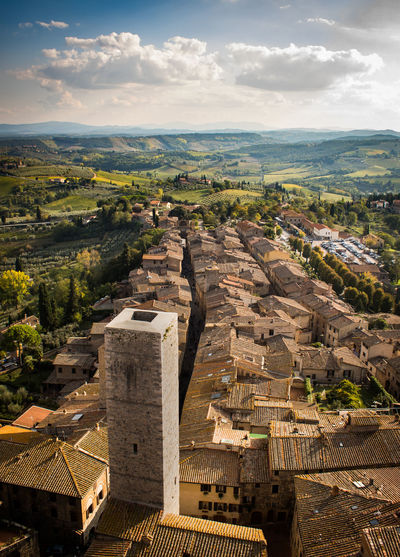 Top View from Tower in San Gimignano Ancient Civilization Architecture Building Building Exterior Built Structure City Cityscape Cloud - Sky Day High Angle View History Landscape Nature No People Outdoors Sky Sunlight The Past Tourism TOWNSCAPE Travel Travel Destinations