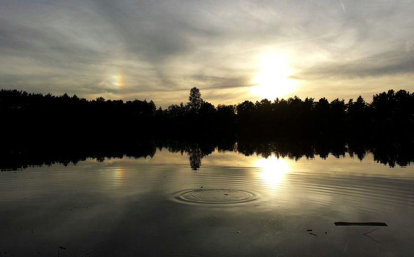 Scenic view of lake at sunset