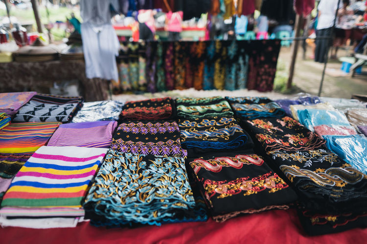 Close-up of multi colored fabrics for sale in market