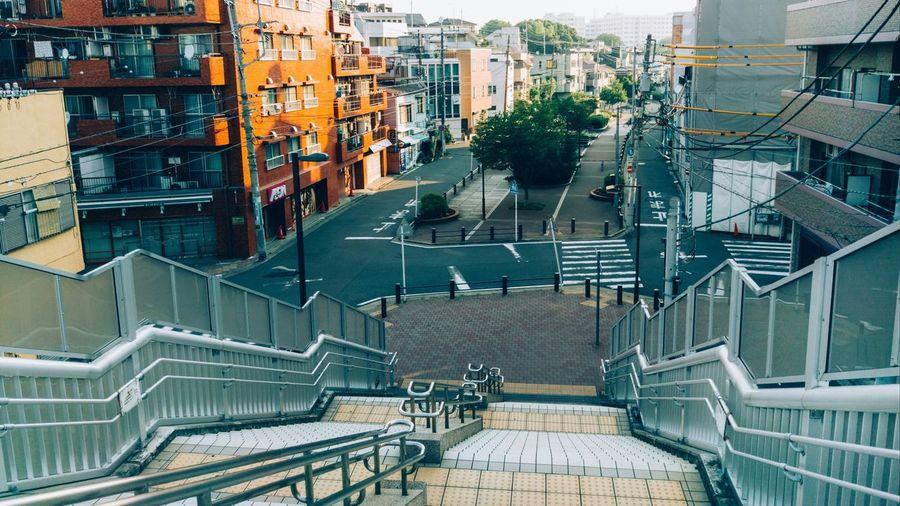 Empty steps leading towards city street