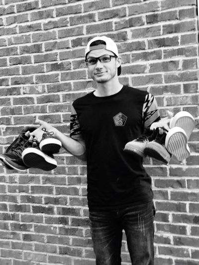 Sneakers Style Brick Wall One Person Real People Looking At Camera Standing Young Adult Day Lifestyles Sneakers For Every Day Sneaker Choices Out Of The Box Sneakers This Ain't All The Kicks