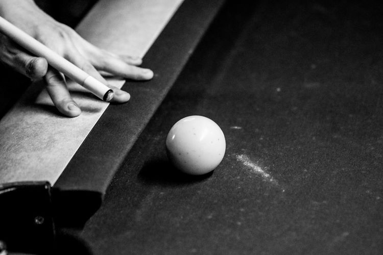 Cropped hand playing snooker