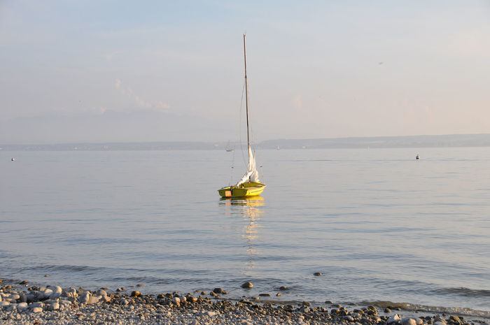 yellow sailboat waiting for big sail Beauty In Nature Horizon Over Water Lake Constance My Place To Dream My Place To Relax Nature Nautical Vessel No People Scenics Sea Sky Tranquil Scene Tranquility Water Yellow Yellow Color