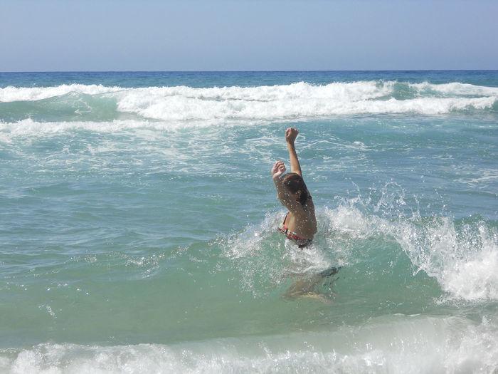 Cheerful Woman Wearing Bikini Enjoying In Sea