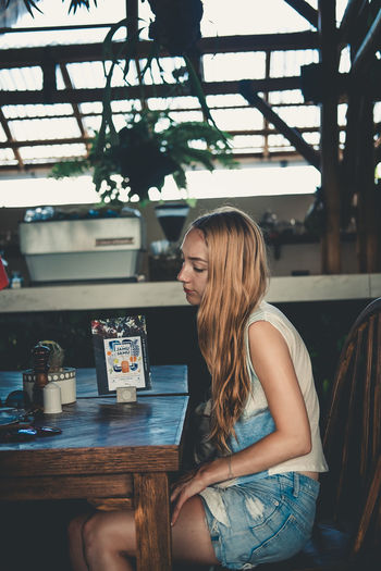 Woman Portrait Stories From The City Leisure Activity Mood Woman Young Adult Cup Women Food And Drink Drink One Person Indoors  Sitting Young Women Beautiful Woman Cafe Hairstyle Contemplation