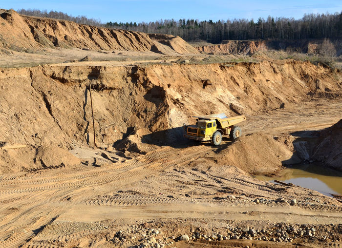 Heavy dump truck working in a sand pit - Image Big Cars Career Work Cargo Dumper Truck Earth Huge Mountain Mountains Multicolored Open Outdoor Quarry Site Stone Stream Tractor Transportation Truck Iron Ore Mining Landscape Breed Career Coal Development Driving Dump Dumper Dumptruck Ecology Energy Environment Equipment Excavator Ground Industrial Iron Large Machine Metal Métier Mine Open Pit Opencast Pit Production Quarry Equipment Quarry Truck Rock Stone-pit Vehicle