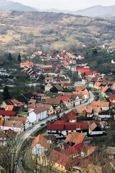 Overview of Cisnadioara Village from Cisnadioara fortified church view point. Curve Houses Road Romania Eyembestshots Full Frame Fullframe Hill Horizon Landscape Mountain Mountain Village Outdoors Sibiu Telephone Line Village