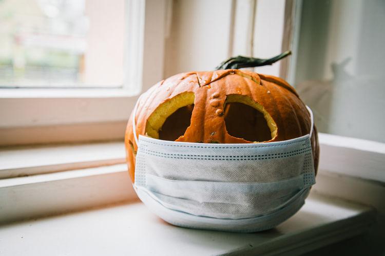 Close-up of pumpkin on window sill