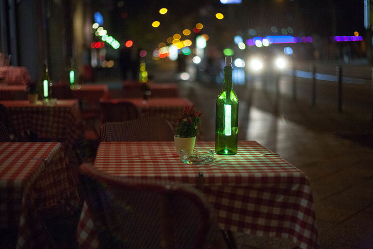 Illuminated table and chairs at night