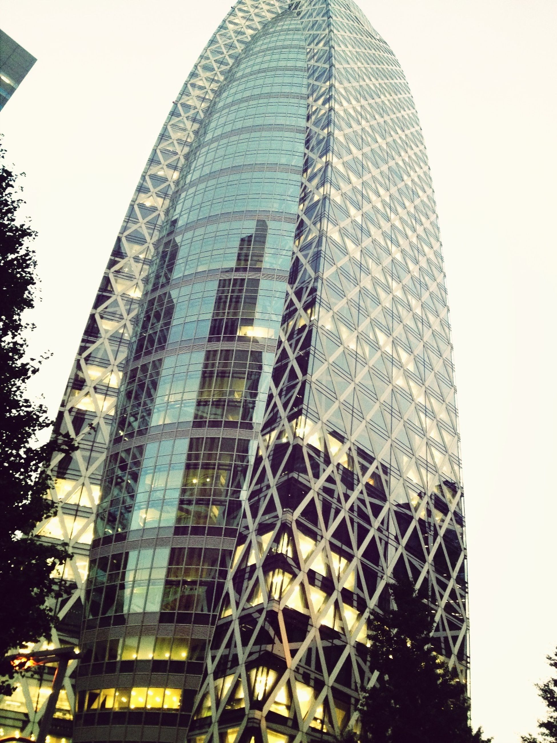 architecture, building exterior, low angle view, built structure, clear sky, modern, office building, building, tower, tall - high, city, window, glass - material, sky, day, pattern, outdoors, skyscraper, no people, growth
