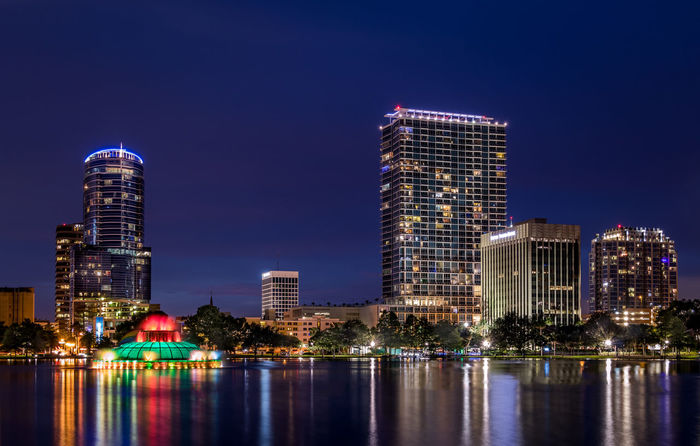 Cityscape of Lake Eola at Night. Downtown Orlando, Florida. Blue Hour Downtown Orlando  Fountain Lake Eola Park Orlando Orlando Florida Architecture Building Exterior Built Structure City Cityscape Illuminated Long Exposure Long Exposure Night Photography Modern Night No People Outdoors Reflection Sky Skyscraper Travel Destinations Urban Skyline Water Waterfront Been There.
