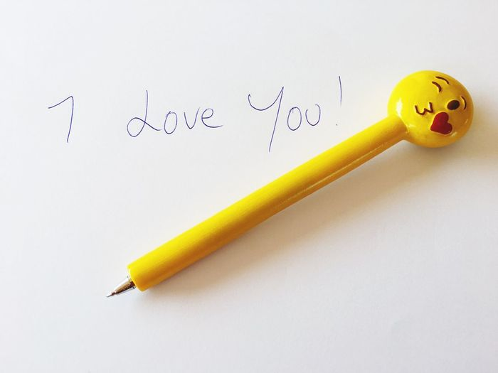I Love You and and 😘 emoticon pen. Yellow White Background No People Close-up Education Indoors  I Love You ❤ I Love You ! Emoticon Pen Biro Message Love Romantic Romance Is Not Dead