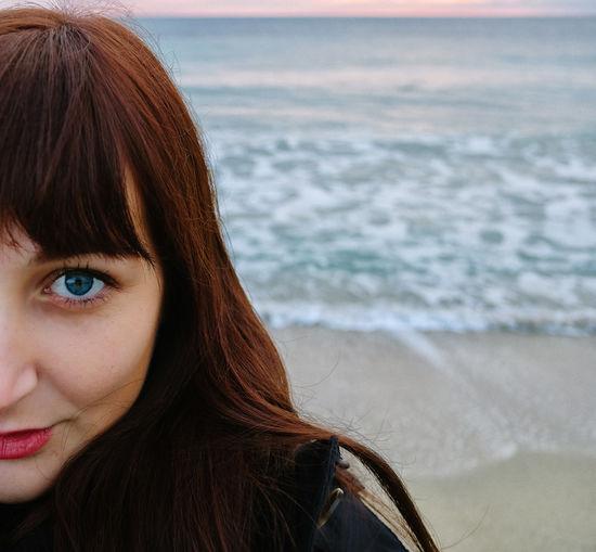 Close-up of woman looking at sea