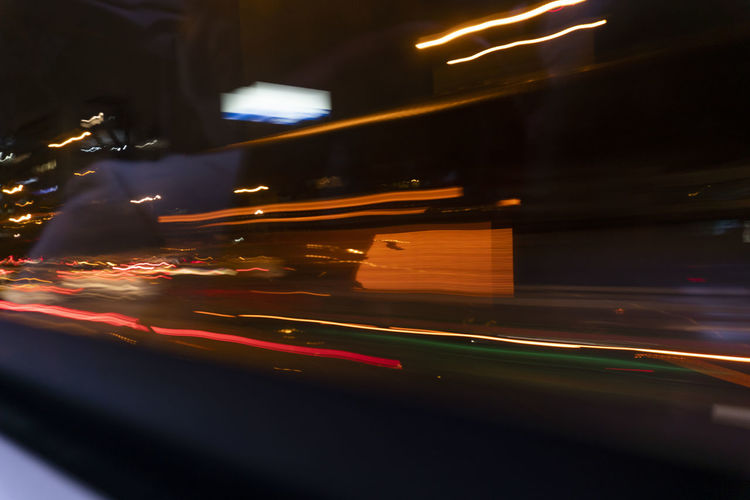 Motion Illuminated Blurred Motion Transportation Night No People City Long Exposure Light Trail Speed Road Indoors  Car Land Vehicle Motor Vehicle Mode Of Transportation Street Light - Natural Phenomenon on the move Architecture Nightlife