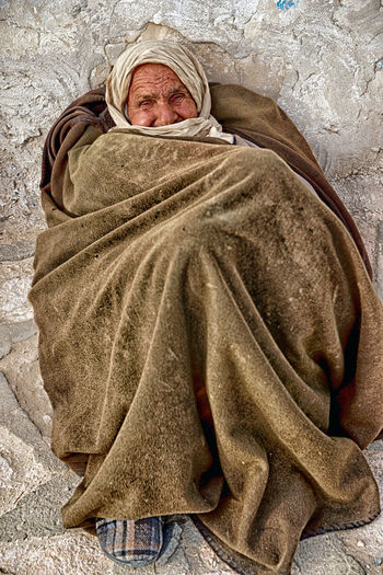 One Person Emotion Men Portrait Religion Adult Spirituality Males  Blanket Clothing Wrapped In A Blanket Belief Childhood Wrapped Indoors  Waist Up Bed Social Issues Contemplation