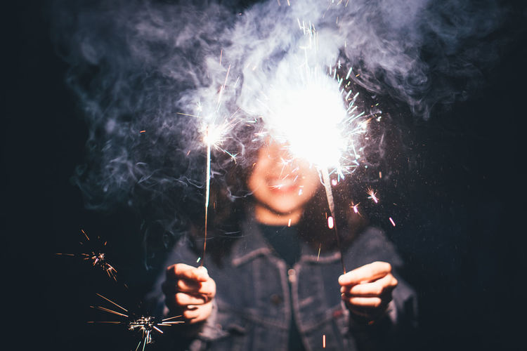 Woman Holding Sparklers At Night
