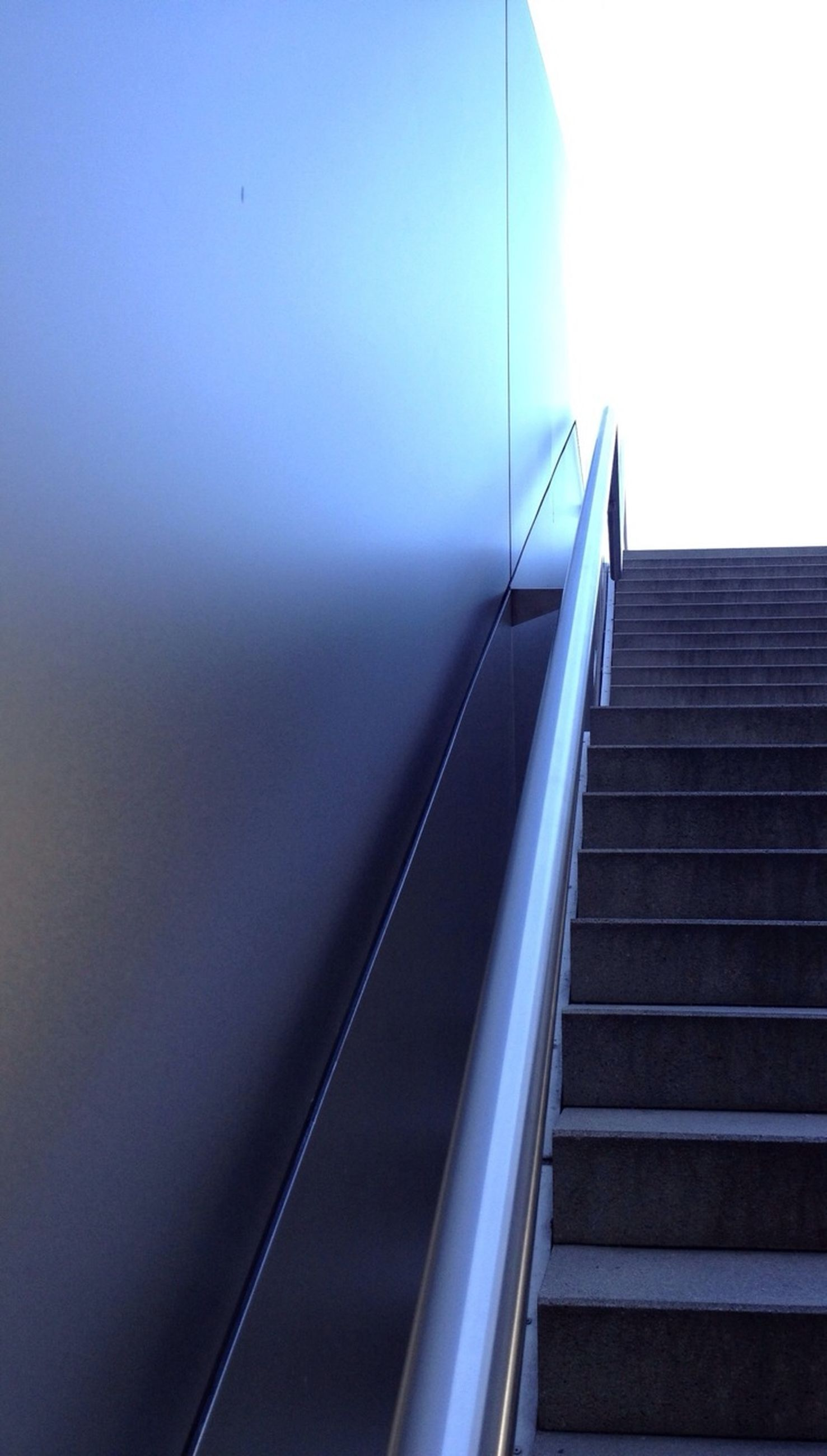 steps, steps and staircases, low angle view, staircase, indoors, built structure, escalator, railing, architecture, transportation, wall - building feature, the way forward, no people, diminishing perspective, modern, technology, day, building exterior, clear sky, sunlight
