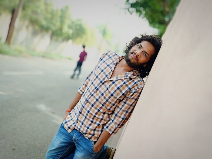 photoshoot Wall Curly Hair Jeans Shirt Long Hair Happy Moments Stylish Boy EyeEm Selects Men Portrait Beard Casual Clothing Posing Thoughtful Friend Denim Casual