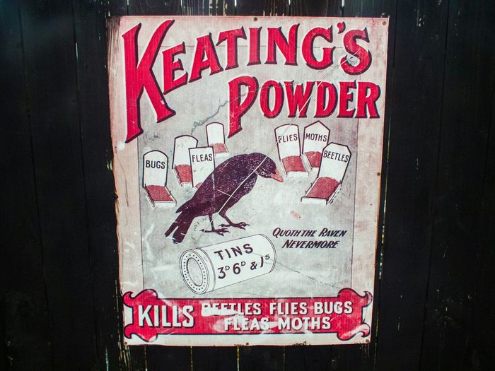 Old Keating's Powder Poster at Summerlee Mine in Coatbridge Colour Image Advertising Nostalgia 1900s Wood - Material Weather Beaten Poison Insecticide Memories Vintage ArtWork Billboard Black Background Cracks Selling Horizontal Old Picture Bugs Pest Control Drawing