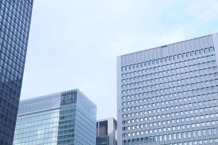 Architecture Built Structure Building Exterior Sky Modern Office Building Exterior Low Angle View Office Building City Glass - Material Day Reflection Skyscraper Nature No People Tall - High Outdoors Clear Sky Financial District  Tokyo