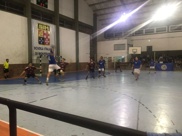 Handball match Handball Match Handball Illuminated Group Of People Architecture Built Structure Real People Large Group Of People Night Crowd Men Indoors  Lighting Equipment Playing Leisure Activity Text Sport Transportation City Communication